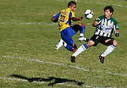 Shelton Timberland FC's goalie Oscar Salvatirra, right, rushes out to challenge Columbia River FC's Mike Chavez during Columbia River's 6-1 win during a regular season matchup of the National Star Soccer League at Bomber Field in Richland on July 3, 2010. Salvatirra was called for a handball outside the penalty box and sent off before Columbia River coach Octavio DoValle asked that he be allowed to stay since Shelton Timberland was playing with only 10 players.