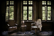 Three chairs by a window