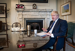 FILE IMAGE from 30th August 2019 © Licensed to London News Pictures. 30/08/2019. London, UK. In this file image Prime Minister Boris Johnson is seen in his office in 10 Downing Street. A countdown clock on the mantelpiece shows the time remaining to the then October 31st deadline for Brexit.  Photo credit: Peter Macdiarmid/LNP