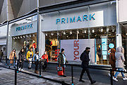With local coronavirus lockdown measures in place and Birmingham currently set at 'Tier 2' or 'high', people, many of whom are wearing face masks entering the flagship Primark store in the city centre on 26th October 2020 in Birmingham, United Kingdom. The three tier system in the UK has levels: 'medium', which includes the rule of six, 'high', which will cover most areas under current restrictions; and 'very high' for those areas with particularly high case numbers. Meanwhile there have been calls by politicians for a 'circuit breaker' complete lockdown to be announced to help the growing spread of the Covid-19 virus.