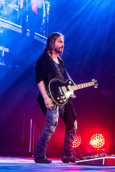 LOS ANGELES, CA - JUNE 20: Guitar player Sergio Vallin of legendary Mexican Rock band Mana perfoms on stage during their Cama Incendiada Tour at Staples Center on June 20, 2015 in Los Angeles, California. Byline, credit, TV usage, web usage or linkback must read SILVEXPHOTO.COM. Failure to byline correctly will incur double the agreed fee. Tel: +1 714 504 6870.