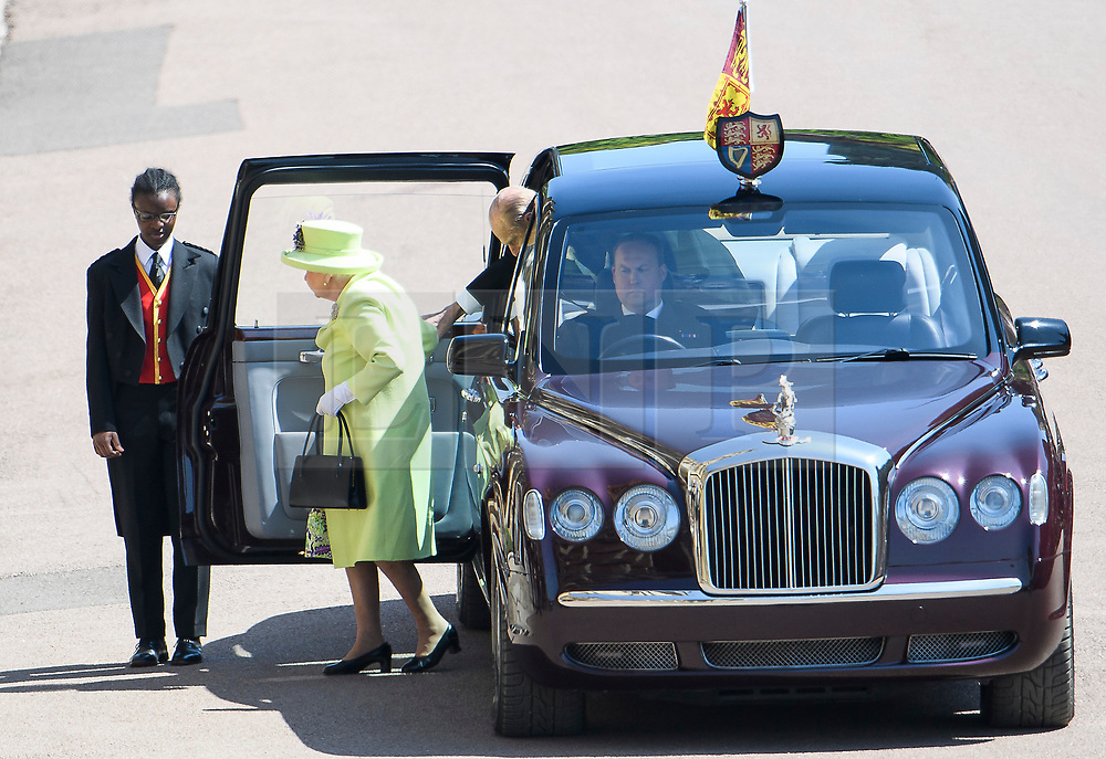 © Licensed to London News Pictures. 19/05/2018. London, UK. HRH QUEEN ELIZABETH II and HRH PRINCE PHILIP, Duke of Edinburgh arrive at The wedding of Prince Harry, The Duke of Sussex to Meghan Markle, The Duchess of Sussex, at St George's Chapel in Windsor. Photo credit: Ben Cawthra/LNP