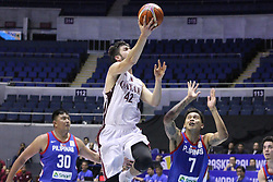 September 17, 2018 - Quezon City, NCR, Philippines - Nasser Khaifa Al-Rayes (White) of Qatar gets past Poy Erram (Blue) of the Philippines to convert a lay-up. (Credit Image: © Dennis Jerome S. Acosta/Pacific Press via ZUMA Wire)