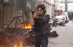 """Elodie Yung as """"Amelia Roussel"""" in THE HITMAN'S BODYGUARD. Photo by Jack English."""