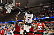 27 MAR 2015: Montrezl Harrell (24) of the University of Louisville goes for a layup over Beejay Anya (21) of North Carolina State University during the 2015 NCAA Men's Basketball Tournament held at the Carrier Dome in Syracuse, NY. Louisville defeated North Carolina State 75-65. Brett Wilhelm/NCAA Photos