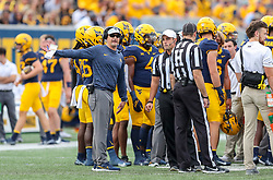 Oct 2, 2021; Morgantown, West Virginia, USA; West Virginia Mountaineers head coach Neal Brown argues a call during the second quarter against the Texas Tech Red Raiders at Mountaineer Field at Milan Puskar Stadium. Mandatory Credit: Ben Queen-USA TODAY Sports