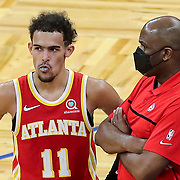 ORLANDO, FL - MARCH 03: Trae Young #11 of the Atlanta Hawks speaks on the sideline with Atlanta Hawks interim head coach Nate McMillan against the Orlando Magic during the second half at Amway Center on March 3, 2021 in Orlando, Florida. NOTE TO USER: User expressly acknowledges and agrees that, by downloading and or using this photograph, User is consenting to the terms and conditions of the Getty Images License Agreement. (Photo by Alex Menendez/Getty Images)*** Local Caption *** Nate McMillan; Trae Young
