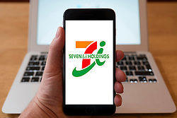 Using iPhone smartphone to display logo of Seven & i Holdings company