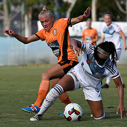 BRISBANE, AUSTRALIA - JANUARY 1: Tameka Butt of the Roar and Samantha Johnson of the Victory compete for the ball during the round 10 Westfield W-League match between the Brisbane Roar and Melbourne Victory at AJ Kelly Park on January 1, 2017 in Brisbane, Australia. (Photo by Patrick Kearney/Brisbane Roar)