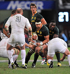 Kings Park, Durban. Springboks vs England. 090612. Springbok eighthman Pierre Spies is stopped by7 the England defence. Picture: Etienne Rothbart.