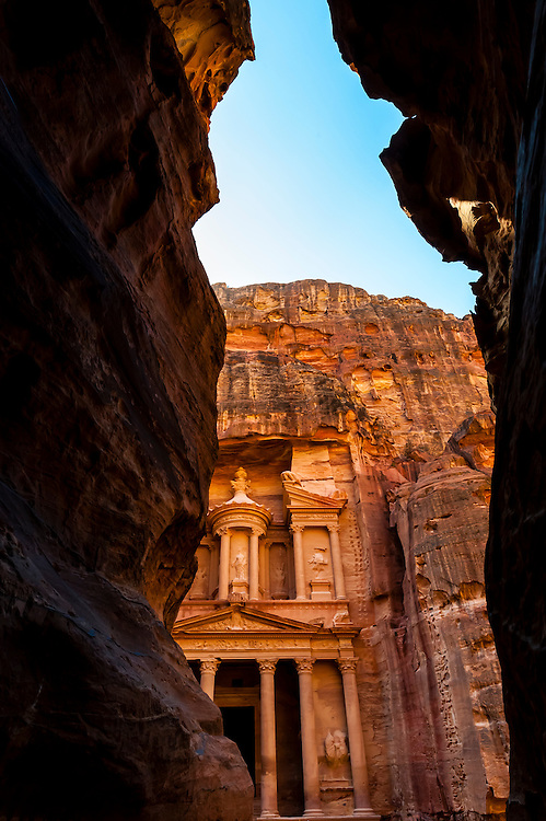 Approaching the Treasury (Al-Khazneh) from the Siq (a 1200 meter long gorge) in the Petra archaeological site (a UNESCO world heritage site), Jordan.