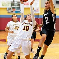 Photo: Jeffery Jones<br /> <br /> Menaul School Lady Panther Mikayla Sierra (2) jumps to block a shot by Rehoboth Lady Lynx Nina Bitsilly (10) during saturday's varsity girls basketball game at Rehoboth Christian School. The Lady Lynx won 54-26.