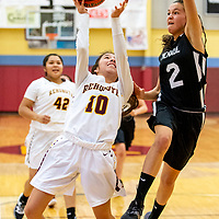 Photo: Jeffery Jones<br /> <br /> Menaul School Lady Panther Mikayla Sierra (2) jumps to block a shot by Rehoboth Lady Lynx Nina Bitsilly (10) during saturday's varsity girls basketball game at Rehoboth Christian School. The Lady Lynx won 54-26.