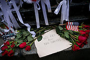 "Roses and the sign: ""We are all New Yorkers"", are photographed on the street in Lower Manhattan, New York, USA, on the 10th anniversary of the 9/11 attacks on the Word Trade Centre."