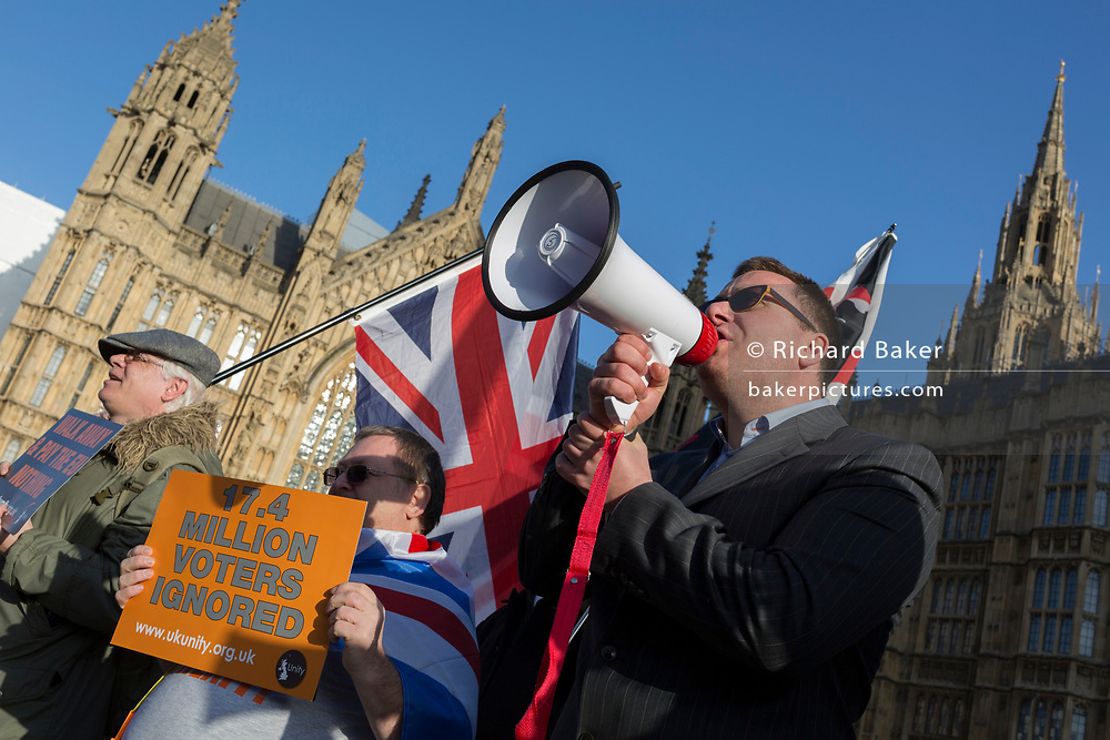 As Prime Minister Theresa May tours European capitals hoping to persuade foreign leaders to accept a new Brexit deal (following her cancellation of a Parliamentary vote), Brexiteers taunt Remainers during protests by both sides opposite the Houses of Parliament, on 11th December 2018, in London, England.
