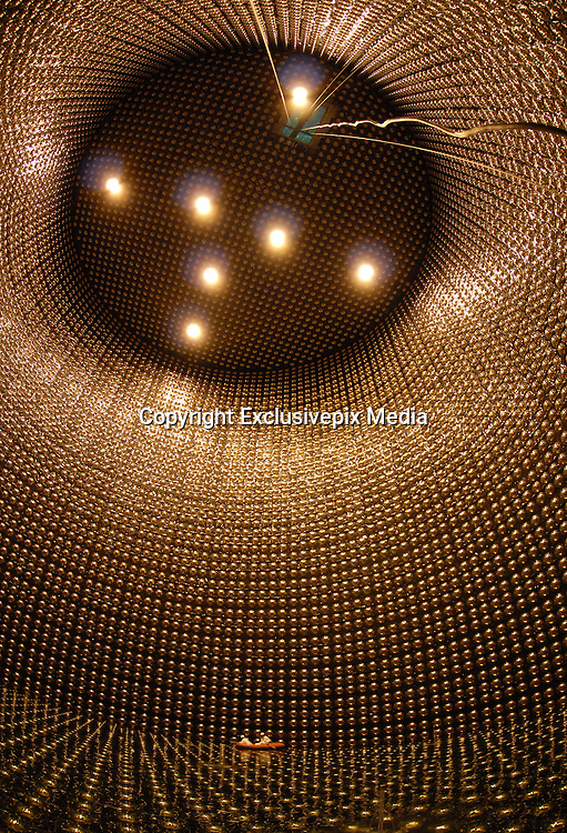 The Surreal World of Neutrino Detectors<br /> <br /> Neutrinos are one of the fundamental particles which make up the universe, but not in the way electrons, protons and neutrons are. These particles are extremely tiny, nearly massless and electrically neutral so they are not affected by electromagnetic forces and react very weakly with other particles of nature. Neutrinos are produced by the decay of radioactive elements in nuclear reactions such as in the core of the sun or exploding stars. Once born, they travel in straight lines at the speed of light passing through solid matter almost entirely unhindered. Although tiny, they carry a colossal amount of energy — some of these carry the same amount of energy as a well hit tennis ball. To detect these particles using the same technology they use at the Large Hadron Collider in Switzerland, one would require a ring of magnets the size of Earth's orbit around the Sun.<br /> Neutrino detectors therefore use entirely different kind of science and technology. Some detectors use large tanks filled with water and surrounded by photomultiplier tubes that watch for radiation emitted when an incoming neutrino creates an electron or muon in the water. Other detectors have tanks filled with chlorine or gallium or other liquids. Neutrino detectors are often built underground, to isolate the detector from cosmic rays and other background radiation.<br /> <br /> <br /> The Super-Kamiokande neutrino detector is located 1,000 meters under Mount Kamioka near the city of Hida, in Japan. The detector consist of a cylindrical stainless steel tank 41 meters by 39 meters holding 50,000 tons of ultra-pure water and surrounded by more than 11,000 photomultiplier tubes (PMT). It is one of the largest detector of its kind.<br /> When a passing neutrino interacts with the electrons or nuclei of water, it can produce a charged particle that moves faster than the speed of light in water. This creates a cone of light known as Cherenkov radiation, which is the optical equivalent to a s