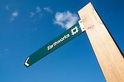 English Heritage signpost arrow for the Neolithic Hatfield earthworks site at Marden, Wiltshire, England