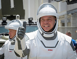 In this photo released by the National Aeronautics and Space Administration (NASA), NASA astronauts Robert Behnken, foreground, and Douglas Hurley, wearing SpaceX spacesuits, are seen as they depart the Neil A. Armstrong Operations and Checkout Building for Launch Complex 39A to board the SpaceX Crew Dragon spacecraft for the Demo-2 mission launch, Saturday, May 30, 2020, at NASA's Kennedy Space Center in Florida. NASA's SpaceX Demo-2 mission is the first launch with astronauts of the SpaceX Crew Dragon spacecraft and Falcon 9 rocket to the International Space Station as part of the agency's Commercial Crew Program. The test flight serves as an end-to-end demonstration of SpaceX's crew transportation system. Behnken and Hurley are scheduled to launch at 3:22 p.m. EDT on Saturday, May 30, from Launch Complex 39A at the Kennedy Space Center. A new era of human spaceflight is set to begin as American astronauts once again launch on an American rocket from American soil to low-Earth orbit for the first time since the conclusion of the Space Shuttle Program in 2011. Photo by Bill Ingalls / NASA via CNP/ABACAPRESS.COM