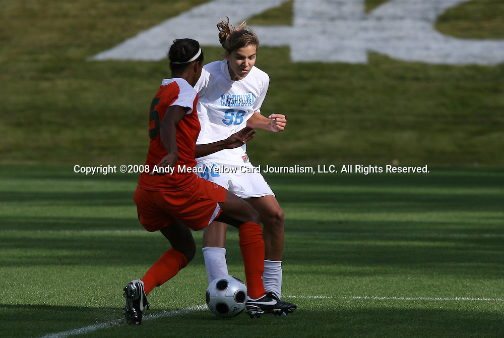 05 November 2008: North Carolina's Tobin Heath (98) scores the game's only goal on this shot between the legs of Miami's Paulelett Ricks-Chambers (5). The University of North Carolina defeated the University of Miami 1-0 at Koka Booth Stadium at WakeMed Soccer Park in Cary, NC in a women's ACC tournament quarterfinal game.
