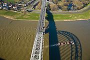 Nederland, Gelderland, Nijmegen, 11-02-2008; Waalsprong: aan de noordoever van de Waal, rond het dorp Lent zal een nieuw stadsdeel gebouwd gaan worden; ook wordt op deze lokatie een geul uitgegraven, meer landinwaarts ten opzicht van de rivier, om de rivier meer de ruimte te geven, Lent (aan de dijk) komt dan op een eiland te liggen; geul, waalbrug, boogbrug, vakwerkbrug..luchtfoto (toeslag); aerial photo (additional fee required); .foto Siebe Swart / photo Siebe Swart