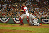 BOSTON - OCTOBER 7:  Juan Uribe #5 of the Chicago White Sox put down a perfect suicide squeeze bunt in the 9th inning, scoring AJ Pierzynski #12 during Game 3 of the American League Divisional Series against the Boston Red Sox at Fenway Park on October 7, 2005 in Boston, Massachusetts.   The White Sox defeated the Red Sox 5-3 to sweep the Red Sox and advance to the American League Championship Series.