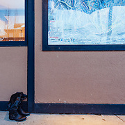 Lone boots sitting next to Nick Wilson's cafe at the base of the tram in the early morning hours.