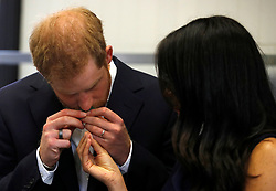 The Duke of Sussex smells traditional native Australian ingredients during a visit to Mission Australia social enterprise restaurant Charcoal Lane in Melbourne, on the third day of the royal couple's visit to Australia.