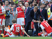 Football - 2016 / 2017 Premier League - Arsenal vs. Everton<br /> <br /> Everton Manager Ronald Koeman consoles dejected Arsenal players Francis Coquelin , Nacho Monreal and Mesut Ozil after failing to qualify for the Champions League after the match at The Emirates.<br /> <br /> COLORSPORT/ANDREW COWIE