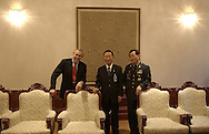.Secretary of Defense Donald H. Rumsfeld, Ministry of National Defense Cho and General Cha Young Ku, Military Defense Commander for South Korea relax at the Blue House in Seoul, South Korea, Nov. 17, 2003.
