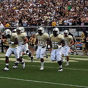 Members of the UCF football team take the field prior to an NCAA football game between the Memphis Tigers and the Central Florida Knights at Bright House Networks Stadium on Saturday, October 29, 2011 in Orlando, Florida. (AP Photo/Alex Menendez)