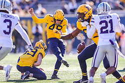 Oct 31, 2020; Morgantown, West Virginia, USA; West Virginia Mountaineers place kicker Casey Legg (48) kicks a field goal during the fourth quarter against the Kansas State Wildcats at Mountaineer Field at Milan Puskar Stadium. Mandatory Credit: Ben Queen-USA TODAY Sports