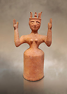 Minoan Postpalatial terracotta  goddess statue with raised arms,  Karphi Sanctuary 1200-1100 BC, Heraklion Archaeological Museum. <br /> <br /> The Goddesses are crowned with symbols of earth and sky in the shapes of snakes and birds, describing attributes of the goddess as protector of nature. .<br /> <br /> If you prefer to buy from our ALAMY PHOTO LIBRARY  Collection visit : https://www.alamy.com/portfolio/paul-williams-funkystock/minoan-art-artefacts.html . Type -   Heraklion   - into the LOWER SEARCH WITHIN GALLERY box. Refine search by adding background colour, place, museum etc<br /> <br /> Visit our MINOAN ART PHOTO COLLECTIONS for more photos to download  as wall art prints https://funkystock.photoshelter.com/gallery-collection/Ancient-Minoans-Art-Artefacts-Antiquities-Historic-Places-Pictures-Images-of/C0000ricT2SU_M9w