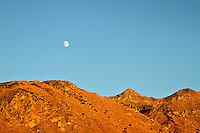 Moon at sunset over Cali desert mountains