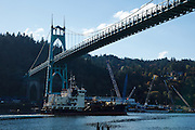 USA, Oregon, Portland, Cathedral Park, USS Yaquina, US Army Corps of Engineers dredging ship passing under St. John's Bridge.