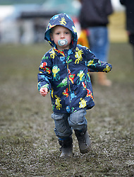 © Licensed to London News Pictures. 10/07/2012..Harrogate, England...Harvey Harris, 2 and a half, from Rossendale in Yorkshire enjoys the muddy conditions on the opening day of the Great Yorkshire Show...England's premier agricultural show opened it's gates today for the start of three days of showcasing the best in British farming and the countryside...The event, which attracts over 130,000 visitors each year is the 154th show and displays the cream of the country's livestock and offers numerous displays and events and gives the chance to see many different countryside activities...Photo credit : Ian Forsyth/LNP