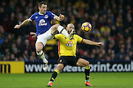 Leighton Baines of Everton gets to the ball ahead of Nordin Amrabat of Watford ®. Premier league match, Watford v Everton at Vicarage Road in Watford, London on Saturday 10th December 2016.<br /> pic by John Patrick Fletcher, Andrew Orchard sports photography.