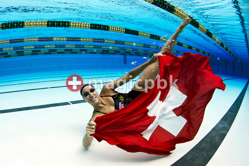 Swimmer Swann OBERSON of Switzerland poses with a Swiss flag during a portrait session after her training session at the outdoor swimming pool (Piscina Comunale) in Bellinzona, Switzerland, Monday, Aug. 8, 2011. (Photo by Patrick B. Kraemer / MAGICPBK)