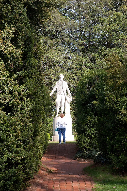 Woman admiring a statue of President James Monroe on the grounds of his home, Ash Lawn Highland.