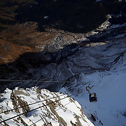 The cabin of the cable car makes its way downhill from the Sonnblick Observatory at 3,106 masl. in the Hohe Tauern mountain range near Rauris, Austria, November 23, 2018. REUTERS/Lisi Niesner