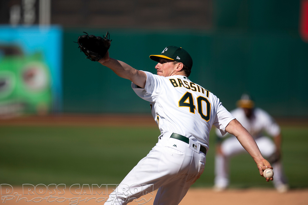 Oakland Athletics pitcher Chris Bassitt (40) delivers against the Texas Rangers during the eighth inning of a baseball game, Sunday, Sept. 22, 2019, in Oakland, Calif. (AP Photo/D. Ross Cameron)