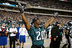 Former Philadelphia Eagle Brian Dawkins gestures to the crowd from the sideline before the NFL football game between the New York Giants and the Philadelphia Eagles on Sunday, September 30th 2012 in Philadelphia. The Eagles won 19-17. Brian Dawkins' jersey number was retired during the game. (Photo by Brian Garfinkel)