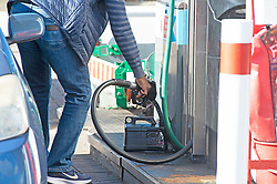 © Licensed to London News Pictures 27/09/2021.<br /> Swanley, UK, This man walked to the station to fill a Jerry can. Chaos at this Co-op petrol station in Swanley, Kent. This station had a delivery at 7.30 am this morning and at 2.30pm started to run out of diesel. Fuel panic buying continues today on forecourts up and down the UK as hoarders run petrol stations dry. Photo credit:Grant Falvey/LNP