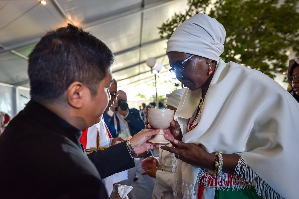 """10 May 2017, Windhoek, Namibia: Holy Communion at the opening worship of the Lutheran World Federation's Twelfth Assembly. The Twelfth Assembly of the Lutheran World Federation, gathers in Windhoek, Namibia, on 10-16 May 2017, under the theme """"Liberated by God's Grace"""", bringing together some 800 delegates and participants from 145 member churches in 98 countries."""