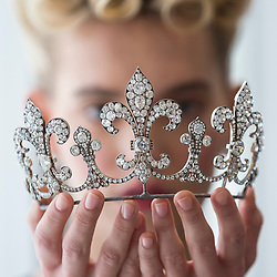 """© Licensed to London News Pictures. 19/10/2018. LONDON, UK. A model presents a diamond tiara, Hübner, circa 1912, of a fleur de lys design, with diamonds (USD350k-550k) from Charles X, King of France. Preview of Sotheby's """"Royal Jewels from the Bourbon-Parma Family"""", a family descended from Louis XIV of France, the Holy Roman Emperors and from Pope Paul III, with links to the most important ruling families of Europe.  Led by a breath-taking group of jewels which once belonged to Marie Antoinette, queen of France, the collection of jewels will be offered for sale at Sotheby's in Geneva on 14 November 2018.  Photo credit: Stephen Chung/LNP"""