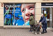 Detail of Tesco Clubcard advertising Newbury, Berkshire, England, UK shoppers wearing masks