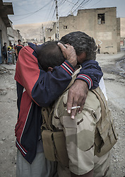 October 27, 2016 - Fadiliyah, Ninewah, Iraq - People hug and celebrate in the town of Fadiliyah. Kurdish Peshmerga forces have liberated Fadiliyah from ISIS. (Credit Image: © Bertalan Feher via ZUMA Wire)