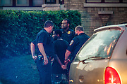 MILWAUKEE, WI -- 8/12/15 -- Police arrest a man at the scene of gun battle in Milwaukee's 7th police district. The 7th district is one of the most violent in the city. The Milwaukee Police Department is under scrutiny for aggressive policing after a series of officer involved shootings, slow response times and illegal strip searches. Police Chief Ed Flynn has made enemies of community leaders, the police union, and conservative groups…by André Chung #_AC13189