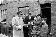23/05/1963<br /> 05/23/1963<br /> 23 May 1963<br /> Mayor of Cork canvasses for Dublin Bye Election. Alderman Sean Casey T.D. mayor of Cork (left) joined in the Labour Party canvassing for their candidate in the Dublin North-East Bye Election, CouncillorDenis Larkin (3rd from left) while passing through Dublin on his way to London. Photo shows when he called with  Councillor Michael Mullins T.D. (2nd from left), at the home of Mrs Michael Lalor, 8 Ardilaun Square, Ballybough, Dublin with her children Michael, Eamonn, Catherine and Mary.