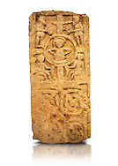 Anglo Saxon cross shaft fragment, 875-999. The cross depicts Christ seated in a halo with two figures above blowing trumpets and two figures below with a horn or a scroll, possibly a last judgement scene. Below are sculpted interlaced patterns. Lindisfarne Abbey Museum, Holy Island, Northumberland, England
