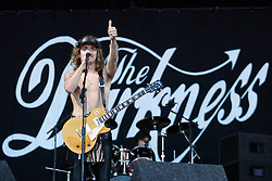 Justin Hawkins, lead singer of The Darkness, open on the main stage at  T in the Park Sunday 13 July 2003..Pic: © Michael Schofield..